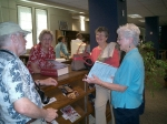 In the Broughton library: Jule Shanklin, Ann Lee Barnhart Robbins,Margie Park Lucas and Cynthia Wing Nichol